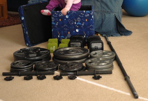 175 pounds of free weights, 50 pounds of fixed dumbbells, two adjustable dumbbells and a 10 pound barbell.